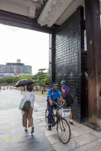 Japan's love for bicycles is seen everywhere, Police being no exception. This is the West entrance to the Osaka Castle, Japan.