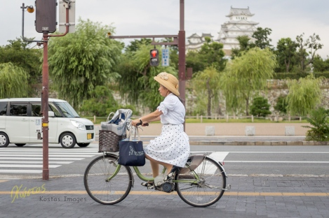 One more photo with a background of the Himeji Castle, this time a portrait of a grandma biker in her dress. Definitely a bike-lover place. Himeji, Japan.
