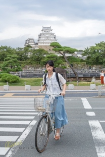 Can't stop having this wonderful castle as my background. Portrait of this lady crossing the street on her bike.