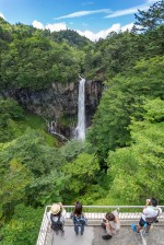 A Beautiful Nature site. Tourists admiring the Kegon Falls in Nikko, Japan.
