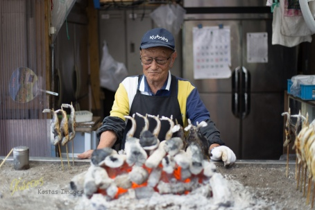 The best snack! Freshly smoked fish (and the portrait of the cook). Kegon Falls, Japan