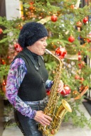 At the entrance of Saint Lawrence Market there she was, a Christmas Carol saxophone player (with Xmas Background)