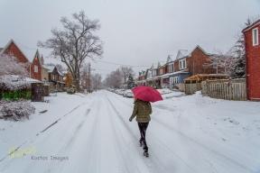 Walking in snow, Toronto street.
