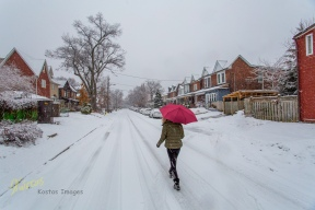 Walking in snow, Toronto street.