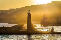 Red Lighthouse at sunset. Napoli, Italy