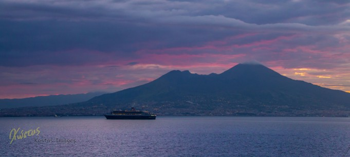 Queen Mary II entering Napoli port. Background: Vesuvius Volcano. Italy