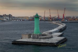 Green Lighthouse at sunset. Napoli, Italy
