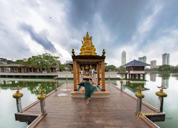Posing in front of the temple Seema Malaka, part of the Gangaramaya Park Lake, Colombo, Sri Lanka