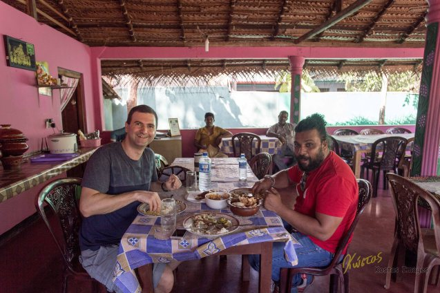 Enjoying some Rice and Curry with our driver and local guide Niro. Of course eating with our hands!