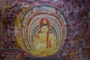 Another painting on the ceiling, which shows the Buddha in blessing pose.