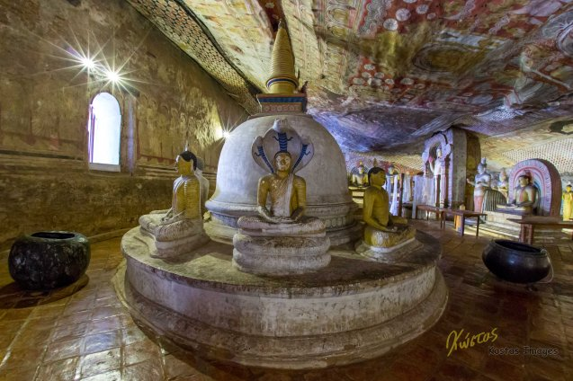 A Stupa with Buddha statues inside the cave