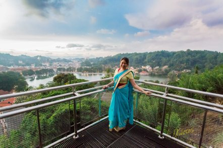 The view from a high point is showing exactly how beautiful Kandy city is. Plus the Saree and sunset colors are complimenting the scene.