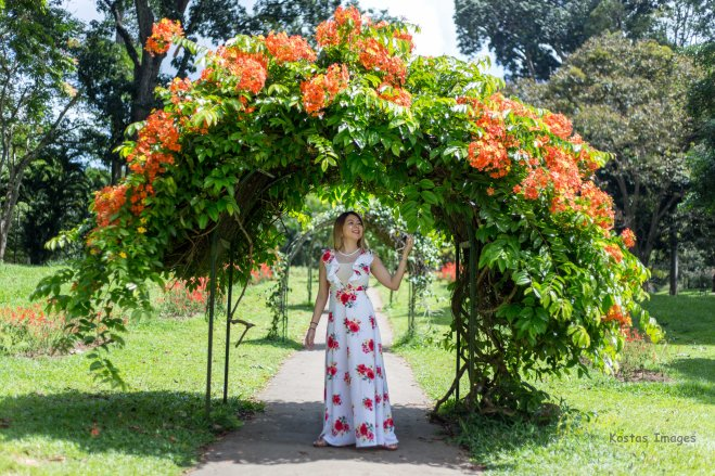 Portrait surrounded by flowers. Royal Botanic Gardens, Kandy, Sri Lanka