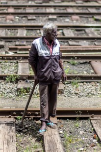 Cleaning the railways from the vegetation is a constant battle, plants grow so fast here. I think this worker was posing a little (while taking a break). Nanu Oya Railway Station, Sri Lanka