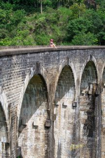 Travelling in Sri Lanka brought us to this magnificent example of engineering and architecture. Nine Arches give this Train Bridge a superb view. I asked my muse to sit there carefully, for a minimalist portrait. Ella, Sri Lanka.