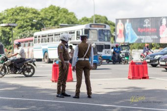 Street traffic in Sri Lanka is insane some times. Police officers standing inside a crossroad triangle in City Center, Colombo, Sri Lanka.