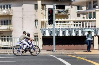 Kids enjoying a bike ride in the city, Colombo, Sri Lanka.