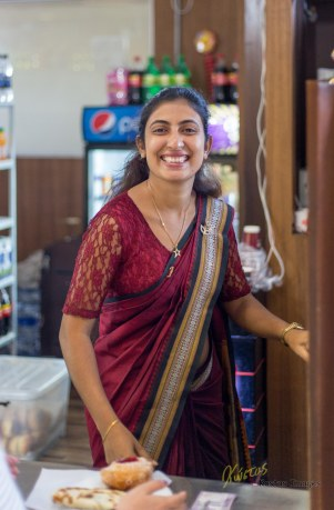 Sri Lanka is saying good bye with a beautiful smile, the lady at the Airport Canteen (of course in Saree). Negombo, Sri Lanka.