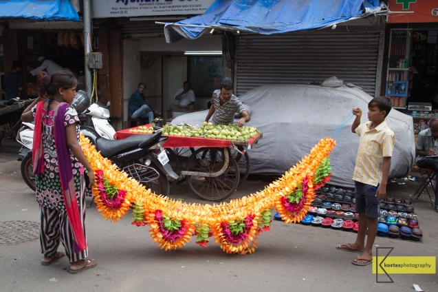 Preparing the flowers for Diwali. Mumbai street.