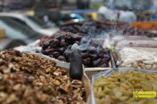 Insence to drive the insects away from the dried fruits and nuts stand, Mumbai street.