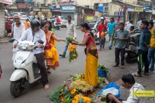 Diwali festival preparation involves flowers, lot's of them. It's not unusual to see street sellers preparing and selling them, Mumbai, India.