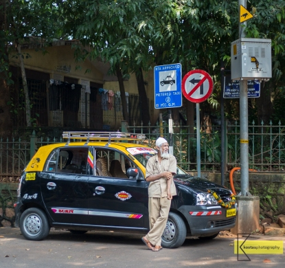 Taxi driver outside the Hanging Gardens in Mumbai.