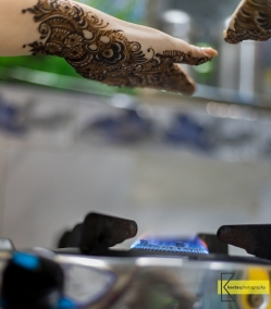 After one side of the Henna tattoo is drawn, the hand has to be dried over fire (especially if you want to finish fast).