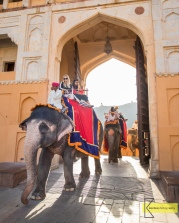 Tourists entering the Amber Palace in Jaipur, on elephants (thus the huge doors).