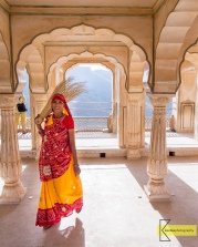 I really enjoy taking photos of people during their daily activities. Candid shots give life to a portrait. This lady was cleaning the Amber Palace in her Saree, when she saw me she wanted to get out of the picture smiling, thinking that she is disturbing. She didn't know that the picture was about her. Jaipur, India.