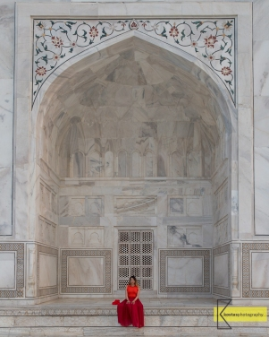 A portrait just in front of Taj Mahal, the size of the architecture is impressive.