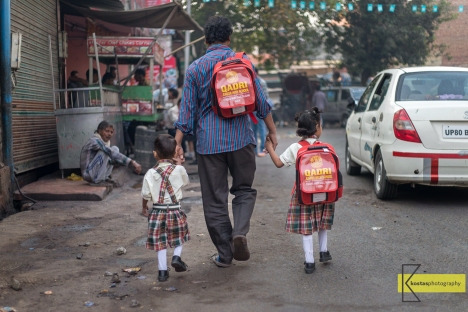 Going to school. Street photography in Agra, India.