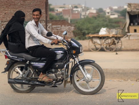 Motorcyclist and wife. Agra, India.
