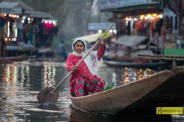 Shopping and moving in Dal Lake involves some rowing. I was on another boat also moving which makes this portrait a moment to remember. Srinagar, Kashmir, India.