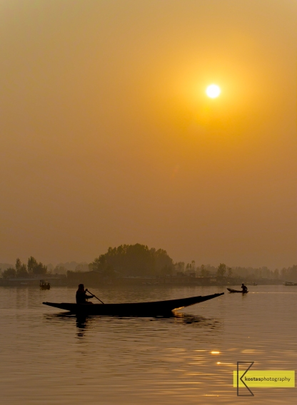 A typical view of the misty winter sunset on Lake Dal, Srinagar, Kashmir.