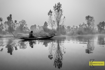 A (cold) moment early in the morning. Reflection, silence and tranquility. Dal Lake, Srinagar, Kashmir.