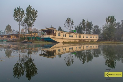 A houseboat in Kashmir, they are used from the locals as residences and also rented to the tourists as floating hotels, Lake Dal, Kashmir.
