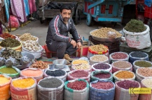 A street seller surrounded by his colorful legumes and veggetables in Srinagar, Kashmir