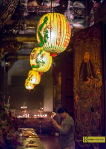 Prayer at Dalongdong Baoan Temple. What I found remarkable in Taiwan is that locals are not bothered by the tourists inside a temple. Of course I tried to be discreet as much as possible. A moment I didn't want to interrupt but I also didn't want to miss this portrait. Taipei, Taiwan.