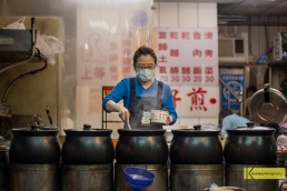 No posing and no preplanning, this is a Real-life portrait of a lady cooking at a Soup Station. Street food is a must try in Taiwan. It's tasty and there is a huge variety to choose from. Shilin Night Market, Taipei, Taiwan.