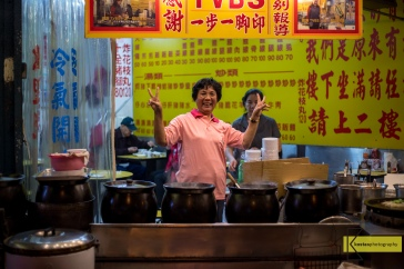 Ready or not Taiwanese are always comfortable in front of the camera. Shilin Night Market, Taipei.