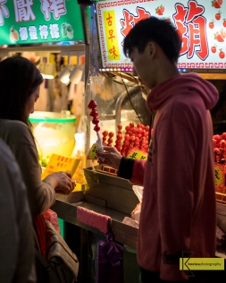 Sugar Coated Cherry Tomato, combination of sweet and sour taste. One of the countless options for food in Shilin Night Market, Taipei, Taiwan.