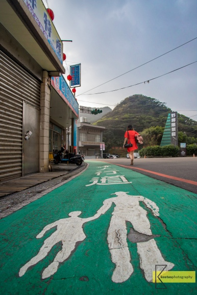 Pedestrian sign on the road at Yehliu village, Taiwan.
