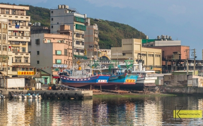 Fishing boats in a dry dock and houses in front of a hill. Morning light gave some good reflection on the water. This is such a typical scene of the place, and also I found it an interesting composition. Yehliu Port in Taiwan.