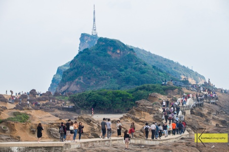 """Yehliu Geopark and Tourists. You can spot the famous rock formation """"Queens Head"""" on the far left side of the photo. The place gets busy early in the day."""