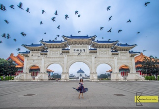 Portrait and birds in front of the famous Chiang Kai-Shek Memorial Hall Gate. A huge construction and temples with endless possibilities for photography. Also with plenty of people visiting. Took us a long wait for this photo to happen. Taipei, Taiwan.