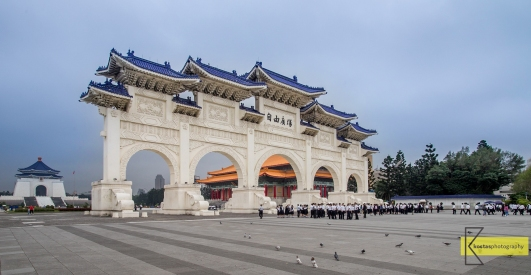 Comparing sizes: A group of students close to the huge gate at 中正紀念堂 Chiang Kai-shek Memorial Hall, Taipei, Taiwan