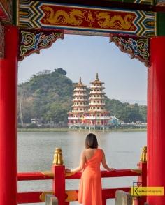 Looking at the Dragon-Tiger Pagodas through the window of the Wuliting 五里亭 Pagoda. Kaohsiung, Taiwan.