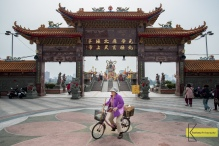 This lady is not posing, she just stopped for a few seconds, I decided to put her in the frame. Main Gate at Great Warrior Statue in Kaohsiung, Taiwan.