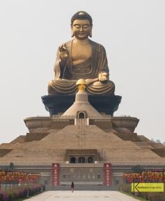 Super minimalist shot of a traveler approaching the gigantic Buddha in Dashu District, Kaohsiung, Taiwan.