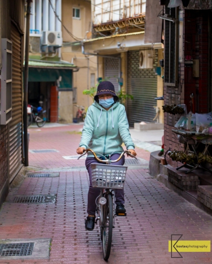 Bicycles in narrow streets are a common view in old Tainan City.